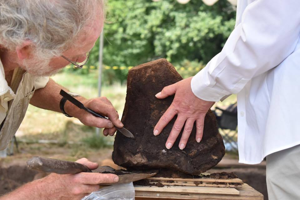Dr Stuart Needham looks at a Bronze Age burial urn excavated at Petersfield Heath
